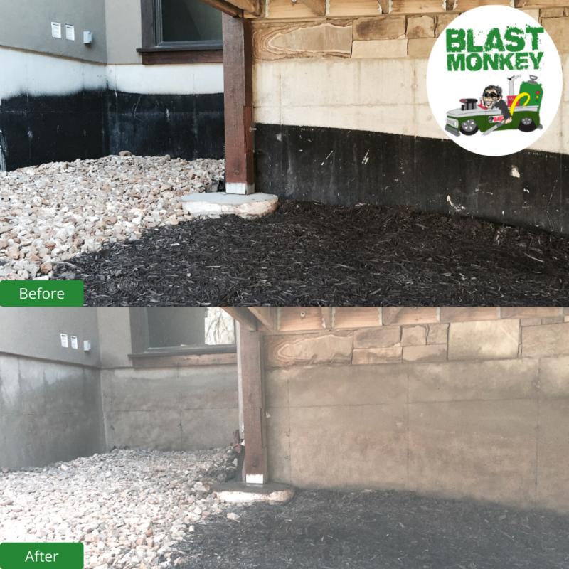 Blasting black paint from concrete foundation Blast Monkey of KC