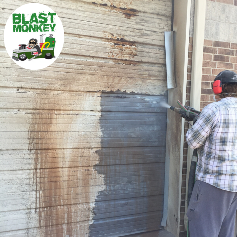 Blasted years of paint and grime from warehouse garage doors